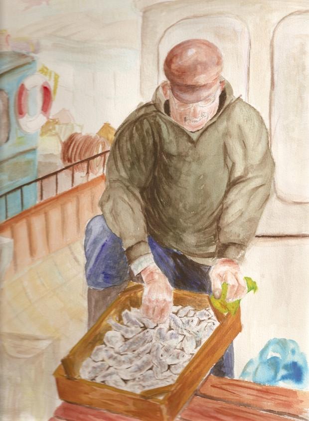 Pescador con caja de pescado